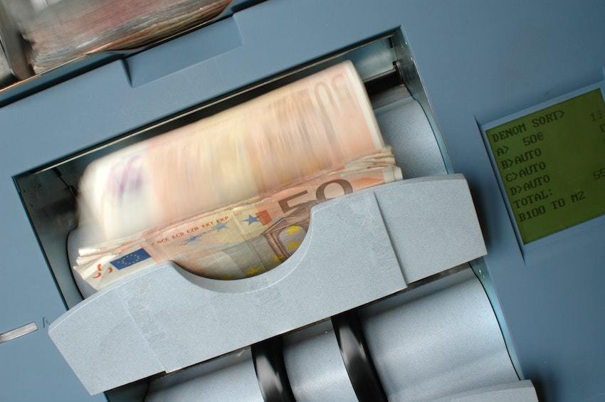 Euros in a bank machine, representing seller financing