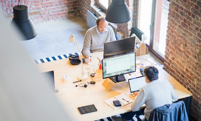 two men work in an industrial space, symbolizing successful startups