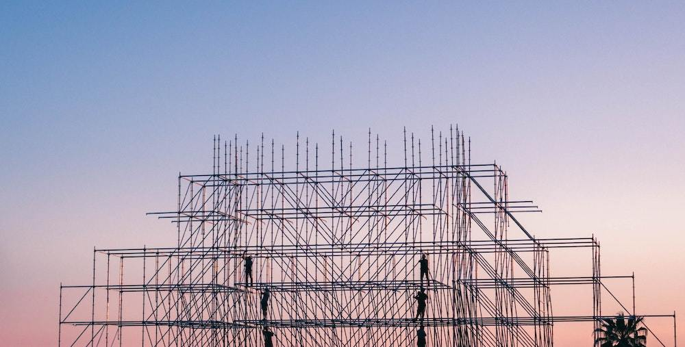 A building frame, symbolizing the 5 Legal M&A Deal Structures in business