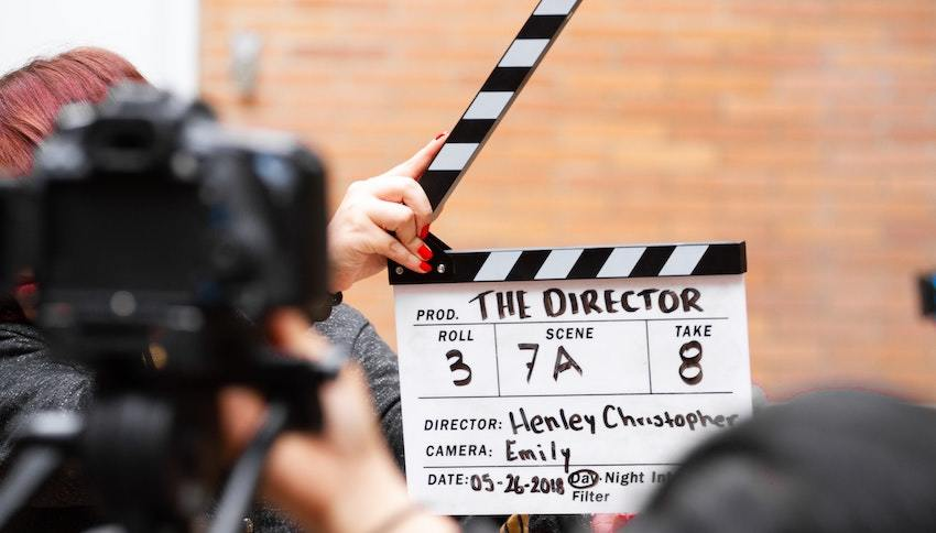 movie clapboard, representing risky investments in Hollywood and elsewhere