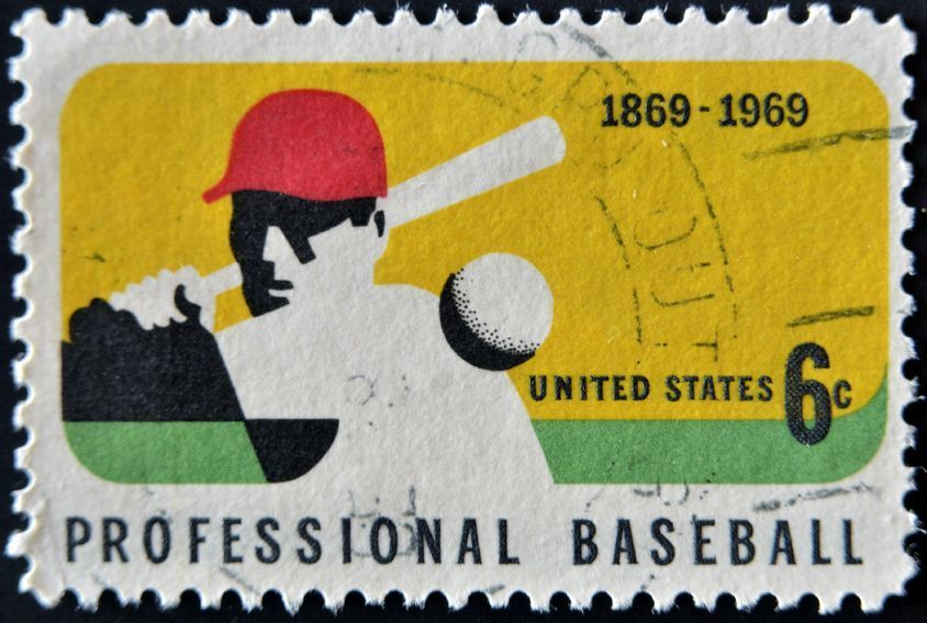 Baseball card investing, as shown by this baseball stamp, is a great example of tangible assets.