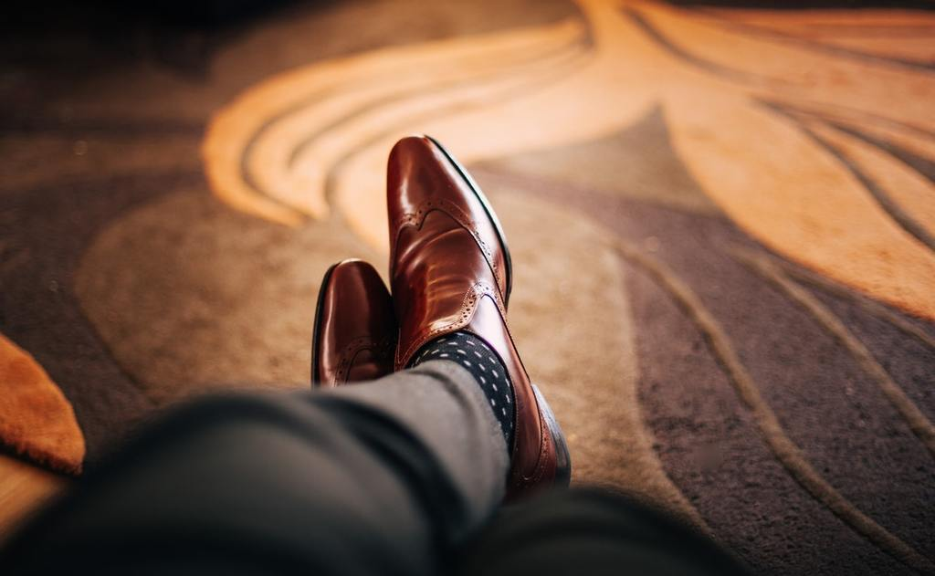 An accredited investors' brown loafers - recently, the accredited investor threshold has changed
