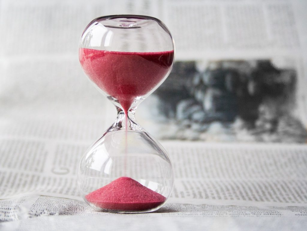 This hourglass with red sand represents the importance of time for fraud statute of limitations