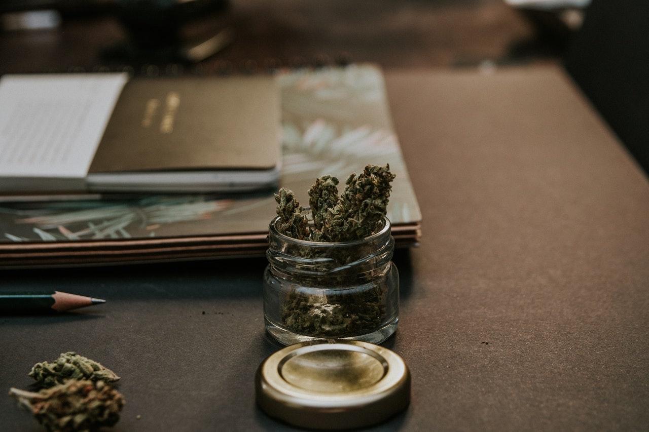 kush on a desk blotter, representing cannabis companies