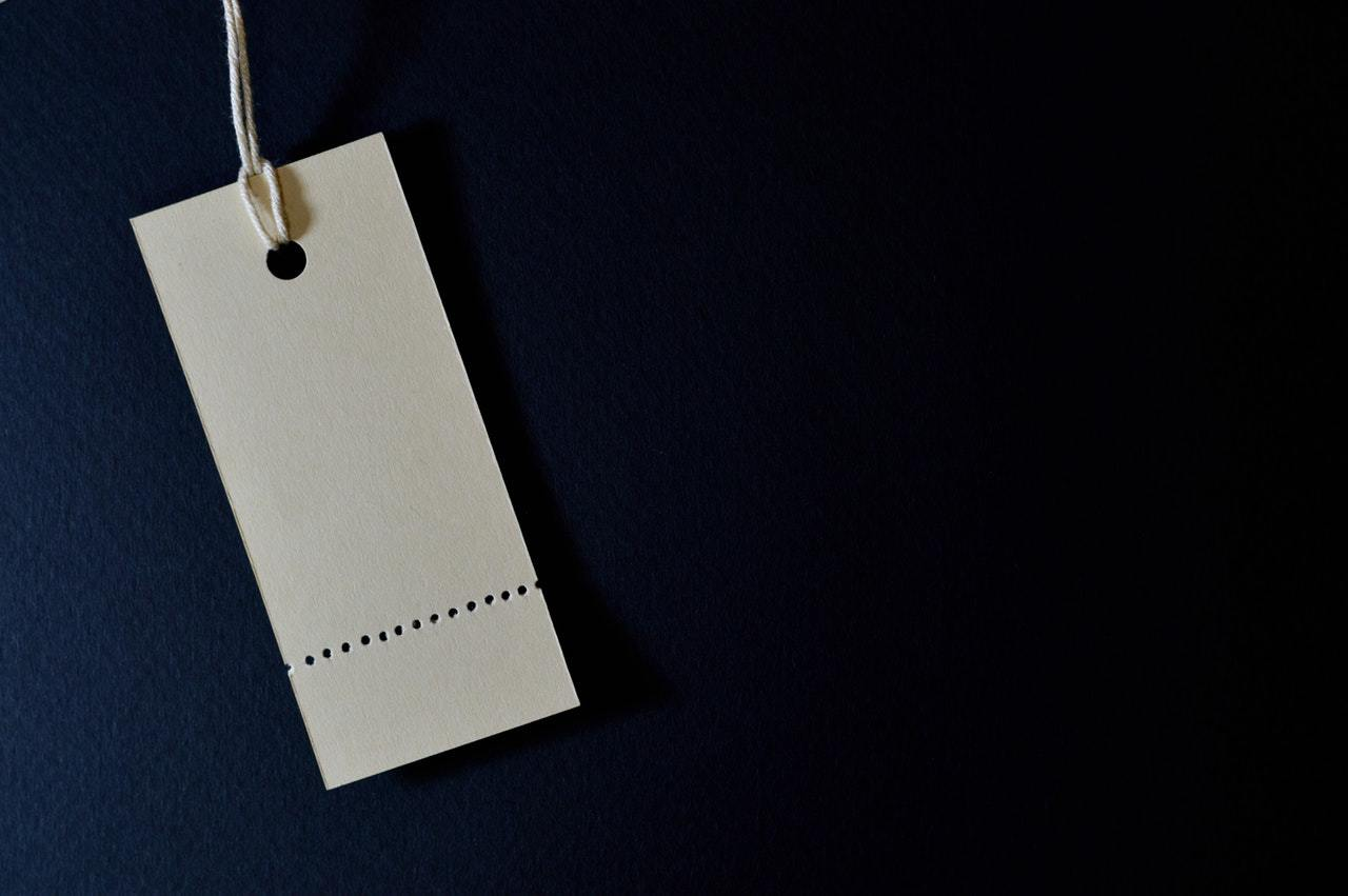 A white sale tag, representing purchase and sale agreements and terms of sale