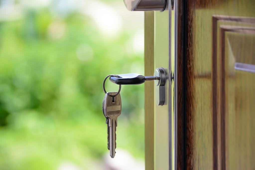 House keys inside an open door, symbolizing real estate exit strategies