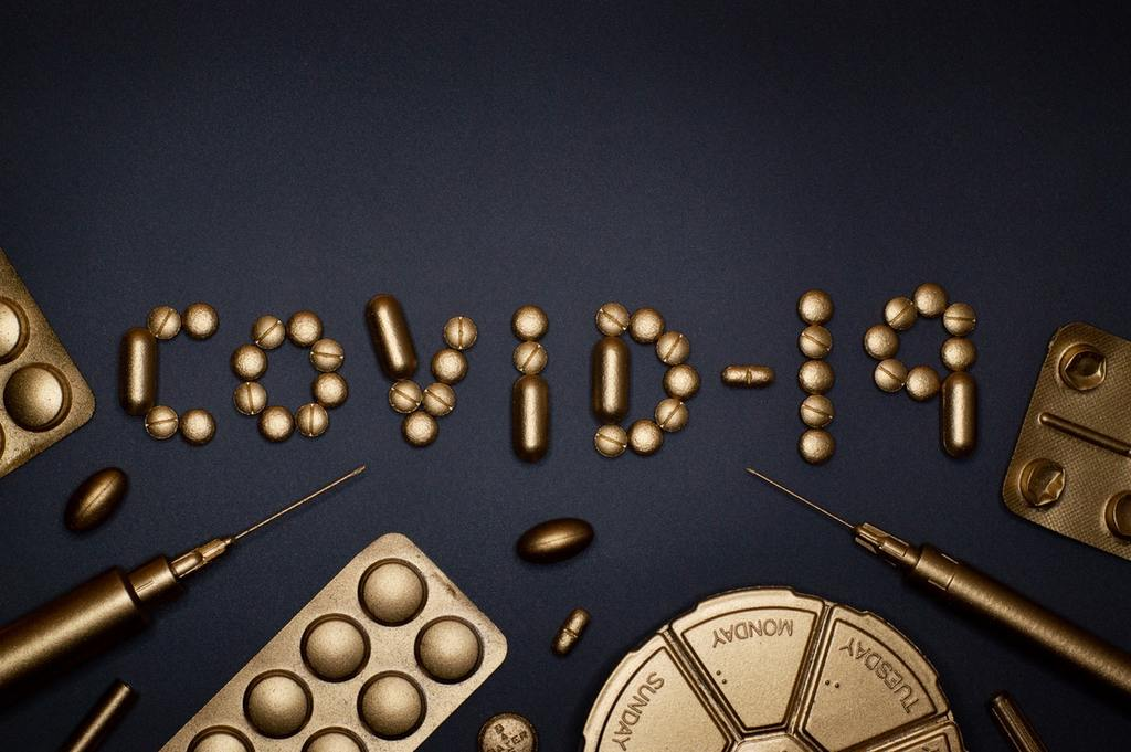 COVID-19 is spelled out with pills and syringes, representing a prescription for business crisis management during the Coronavirus epidemic