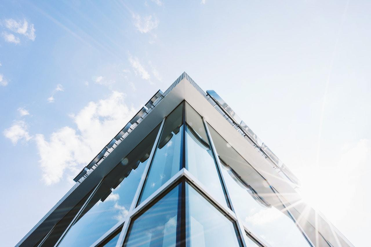 "A glass office building helps to illustrate the question ""what are the advantages of a corporation and corporation management?"