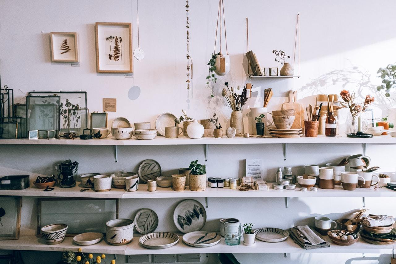 ceramics on wooden shelves, representing how to protect your personal assets