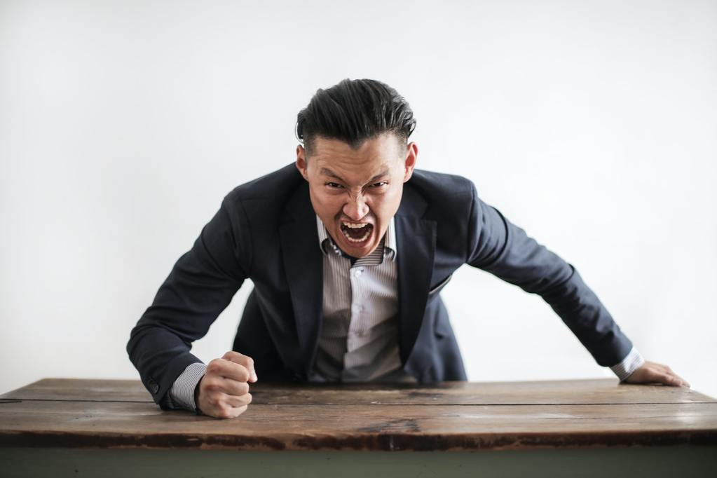 business executive screams, representng bad company culture and changing i