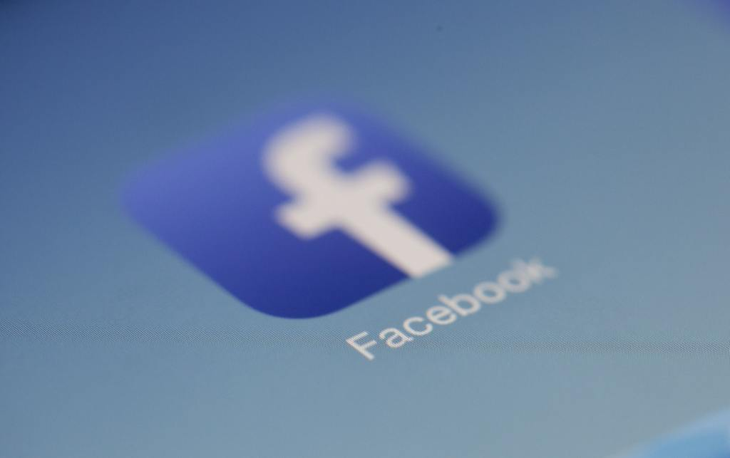 A blurred facebook logo, symbolizing how to promote on facebook using facebook ads