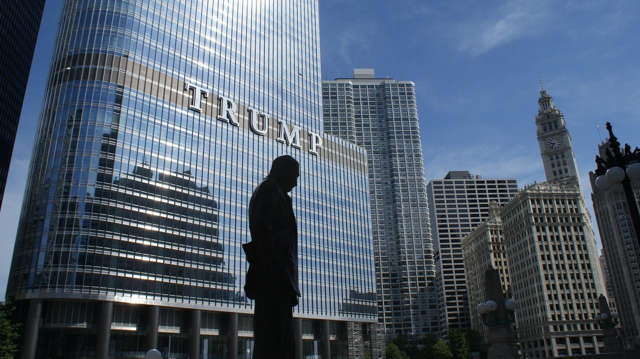 silhouette of a statue near Trump Tower, symbolizing puffery as a legal defense